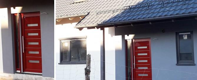 Vchodové hliníkové dvere Evolution na rodinnom dome v červenej farbe